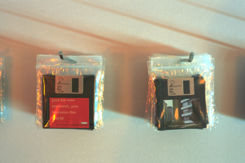 Floppy disks containing the screensavers hanging on the exhibition wall in Santiago de Compostela  (December 1, 2000 - January 14, 2001). Picture: Rony Vissers.