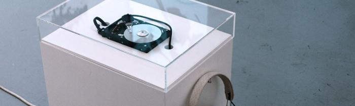 Installation view of 'My Hard Drive Experiencing Some Strange Noises' (2007) by Grégory Chatonsky. Credits: chatonsky.net.